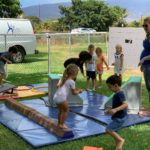 A group of kids with their teacher in an outdoor tumbling class at Little Hoku