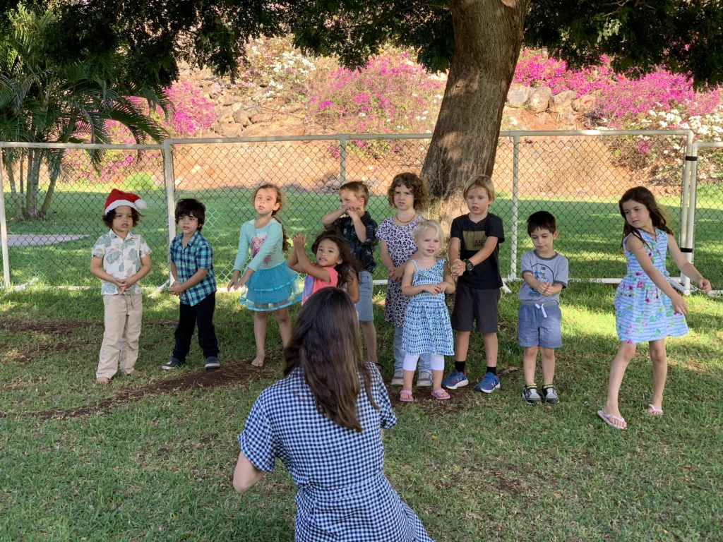 Little Hoku kids playing outside during holiday party