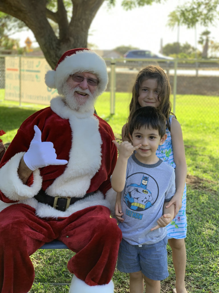 Santa visiting kids at Little Hoku