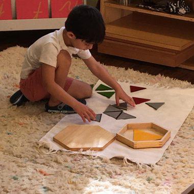 Child doing education activities on floor