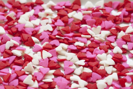 dozens of pink, rent and white valentines heart candies