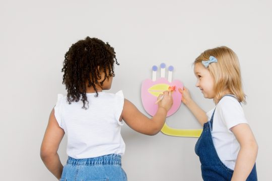 Natural consequences: Two girls creating wall art